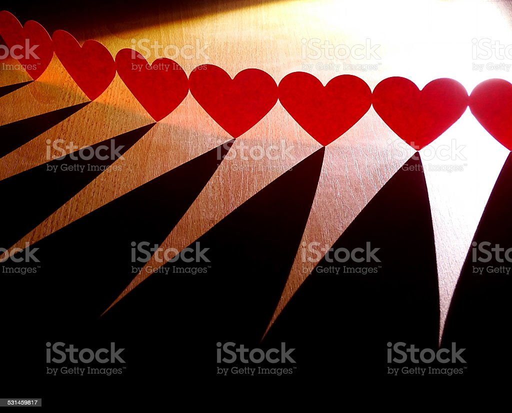 Group of red hearts connected in chain stock photo