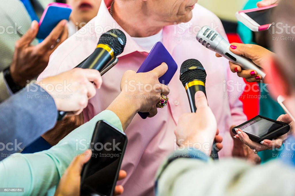 A group of reporters interview political candidate stock photo