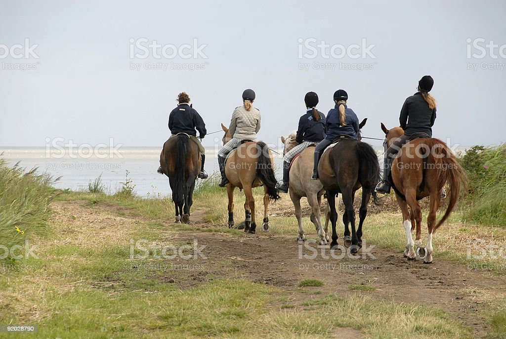 Group of riders at the North Sea stock photo