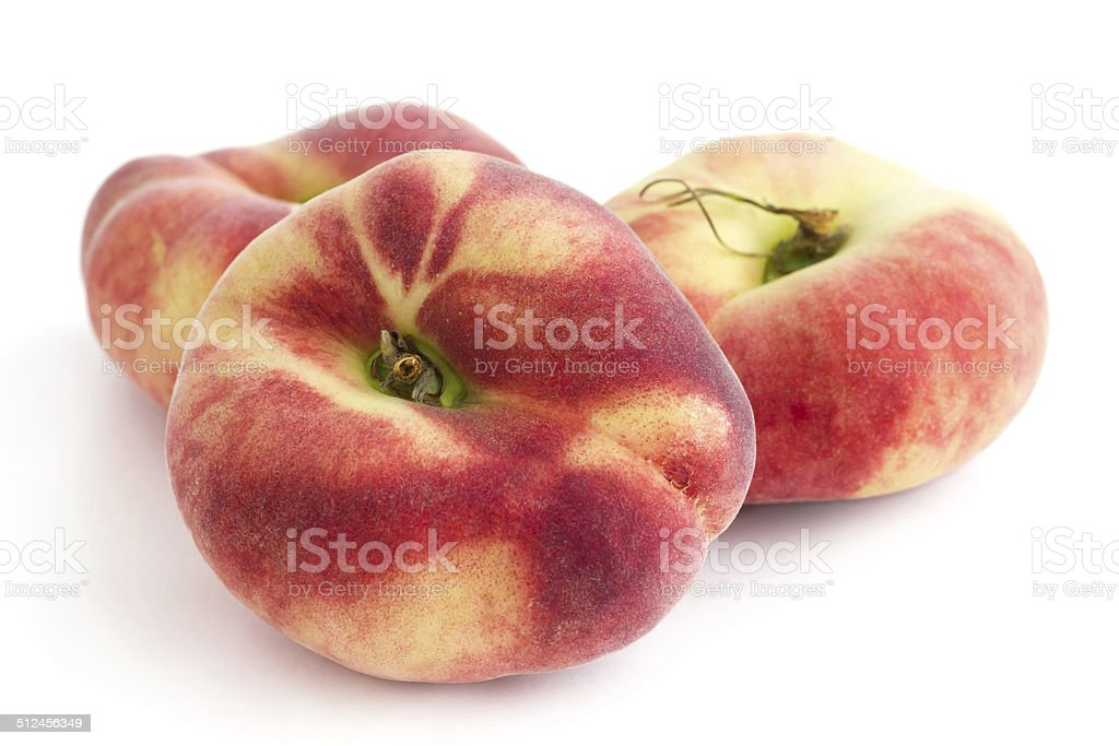 Group of ripe flat peaches on white stock photo