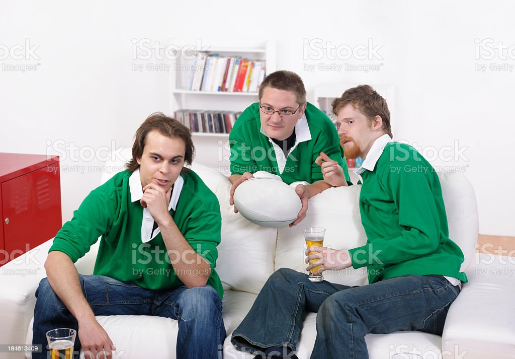 Group Of Rugby Fans/ Supporter Analyzing A Match stock photo