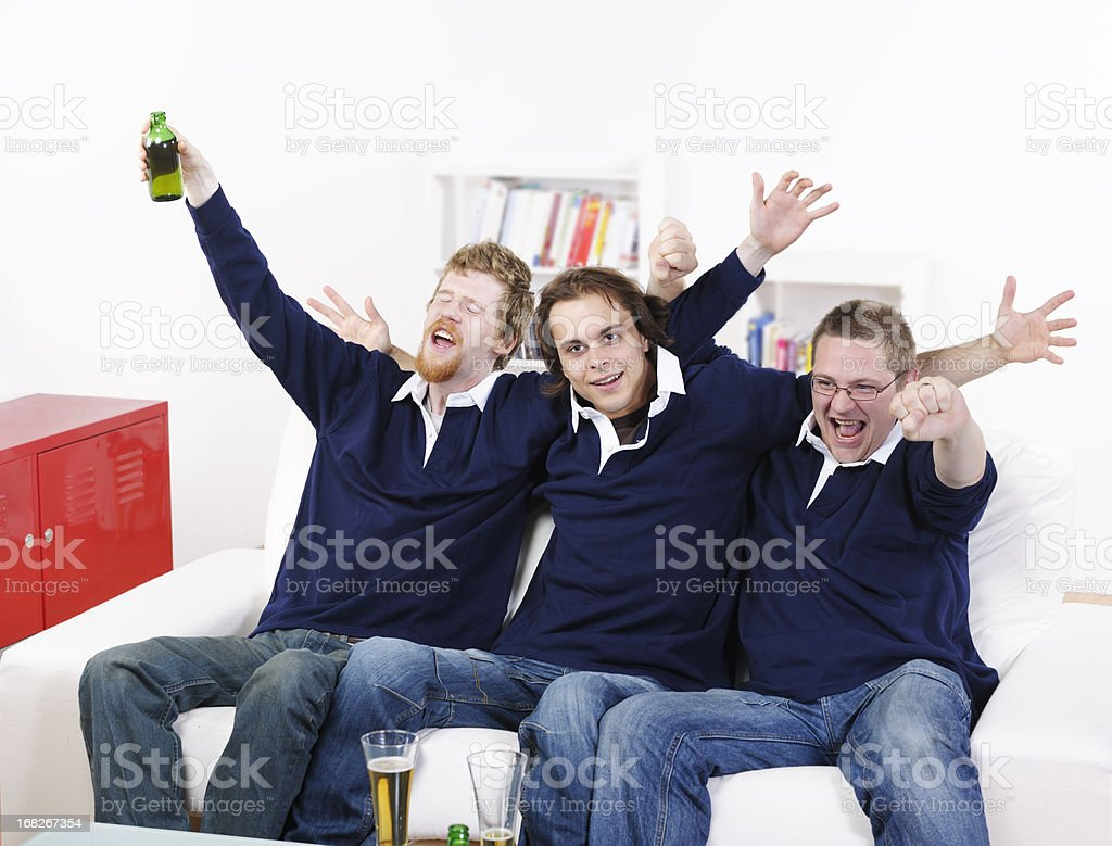 Group Of Rugby Fans/ Supporter Celebrating A Victory stock photo