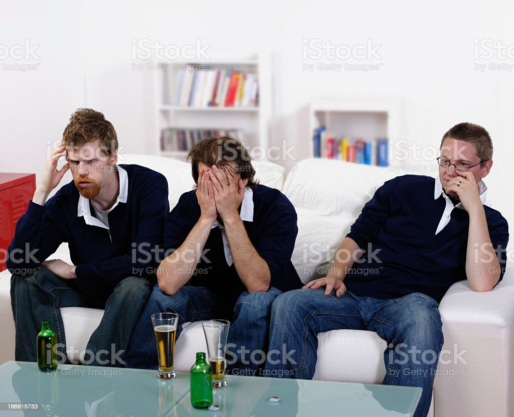 Group Of Rugby Fans/ Supporters Disappointed By Team Performance stock photo
