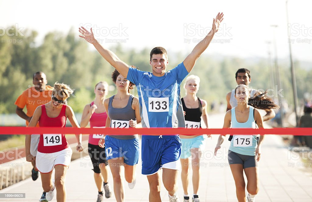 Group of runners finishing the race. stock photo