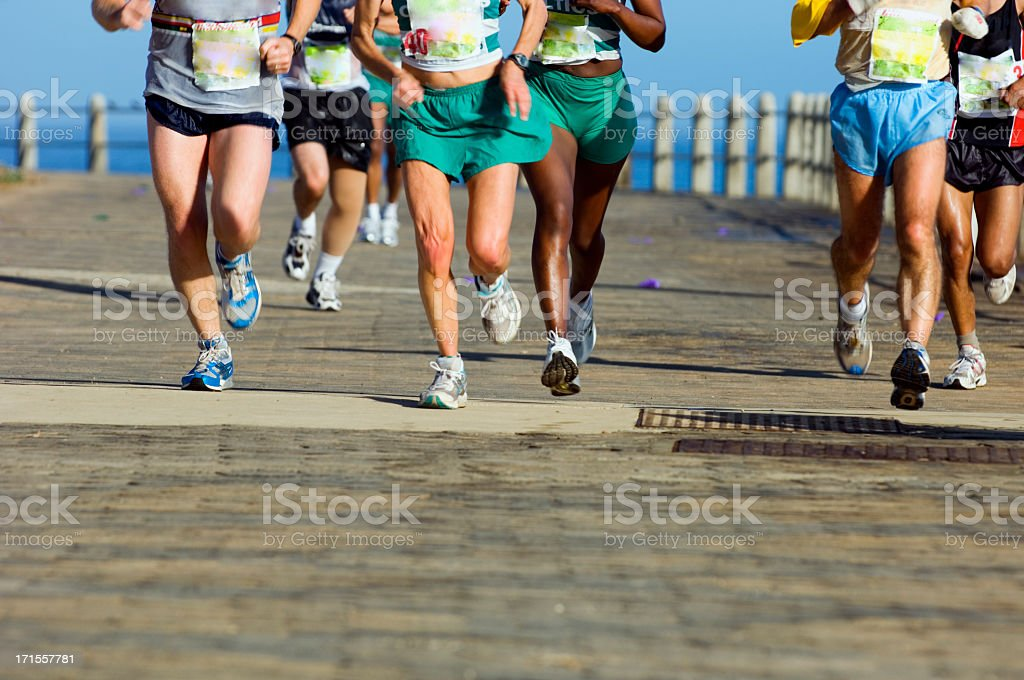 Group of runners on paved road stock photo
