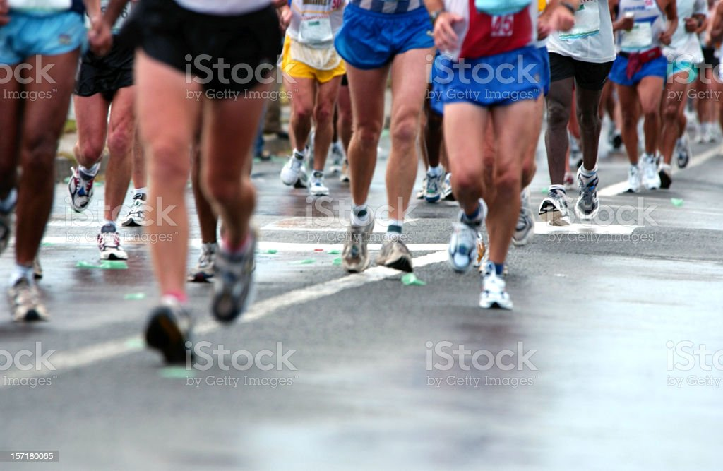 Group of runners on the Road stock photo