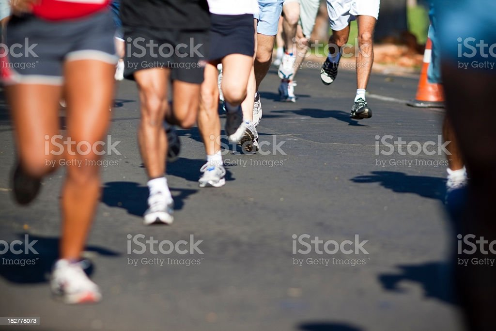 Group of runners on the street stock photo