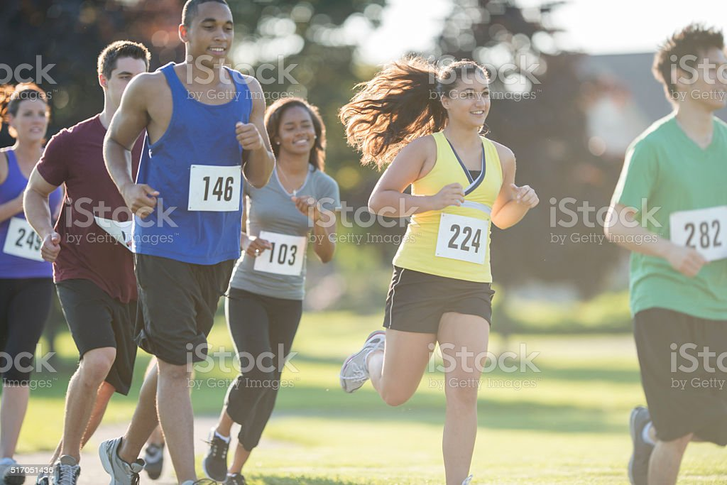Group of Runners Racing Through the Park stock photo