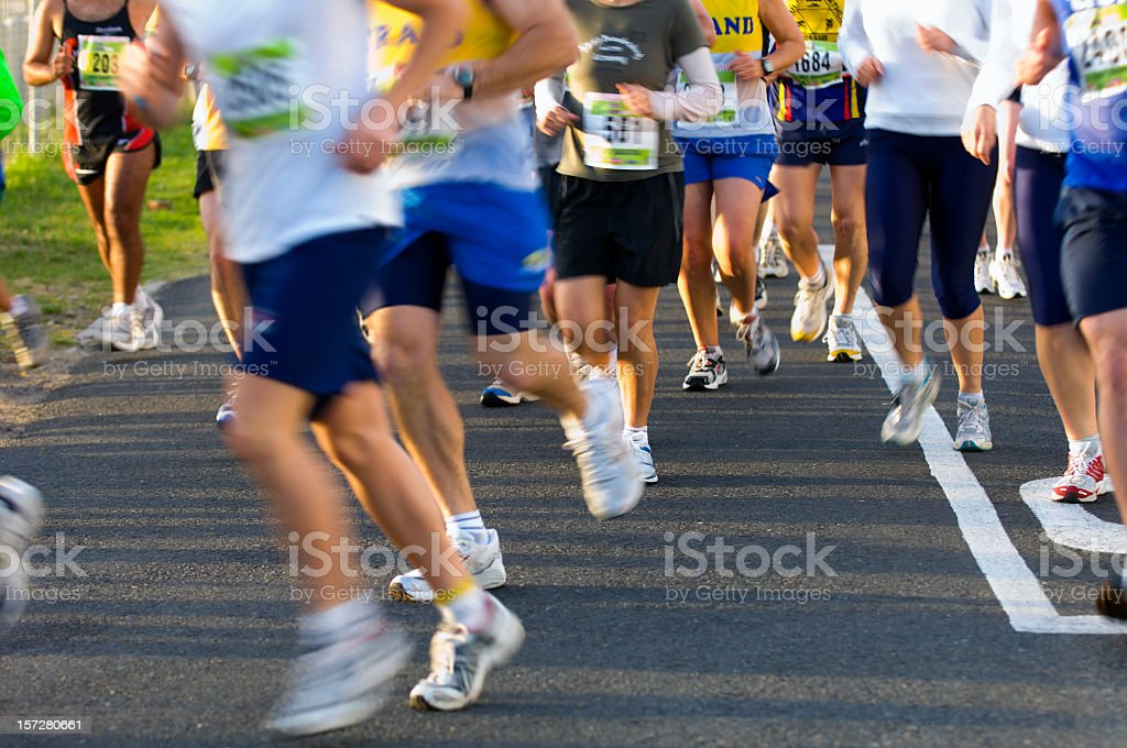 Group of runners taking a bend stock photo