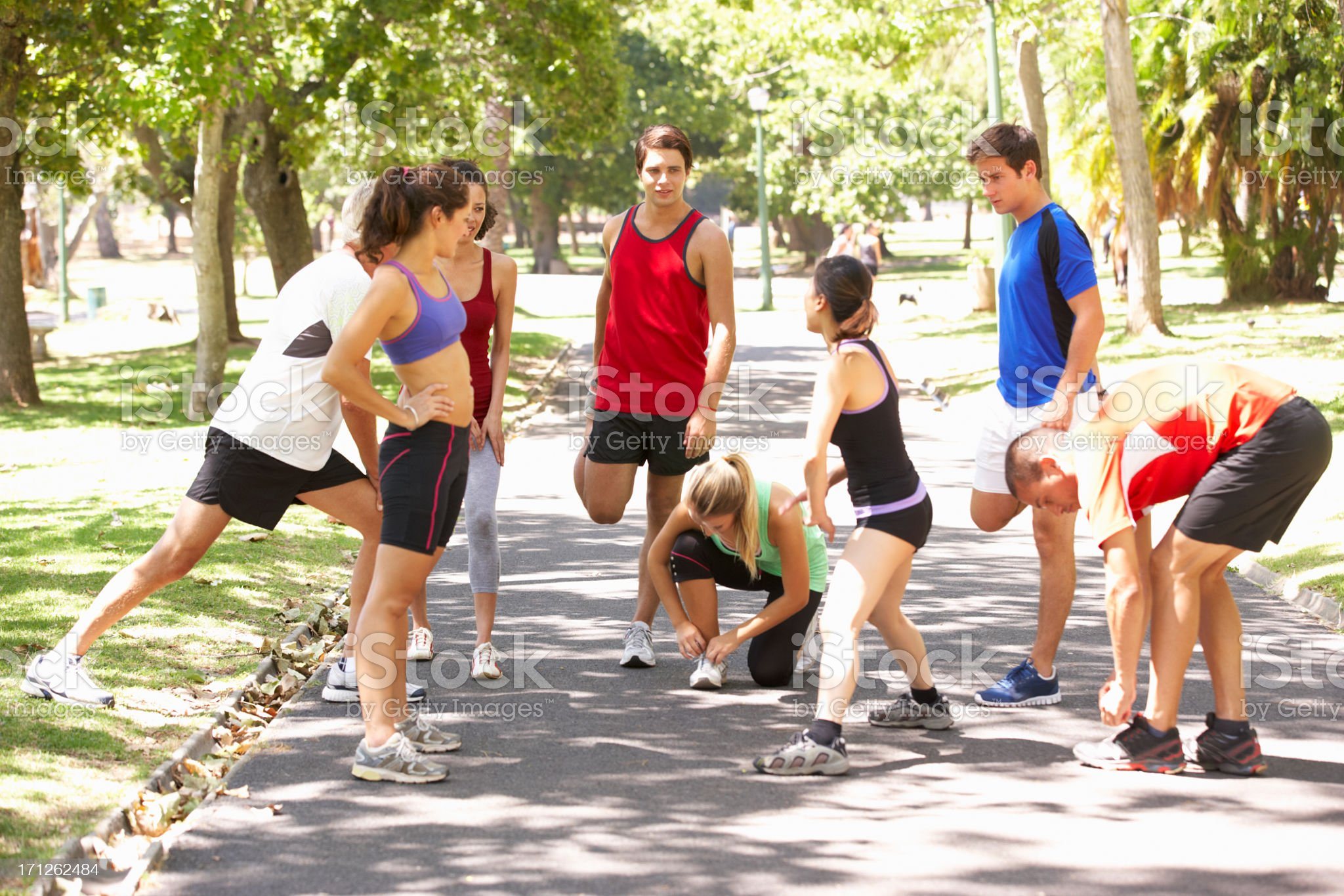 Group Of Runners Warming Up In Park royalty-free stock photo