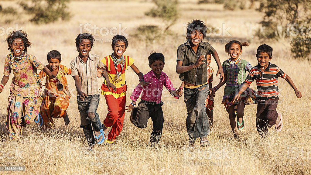 Group of running happy Indian children, desert village, India royalty-free stock photo