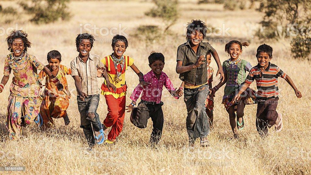 Group of running happy Indian children, desert village, India stock photo