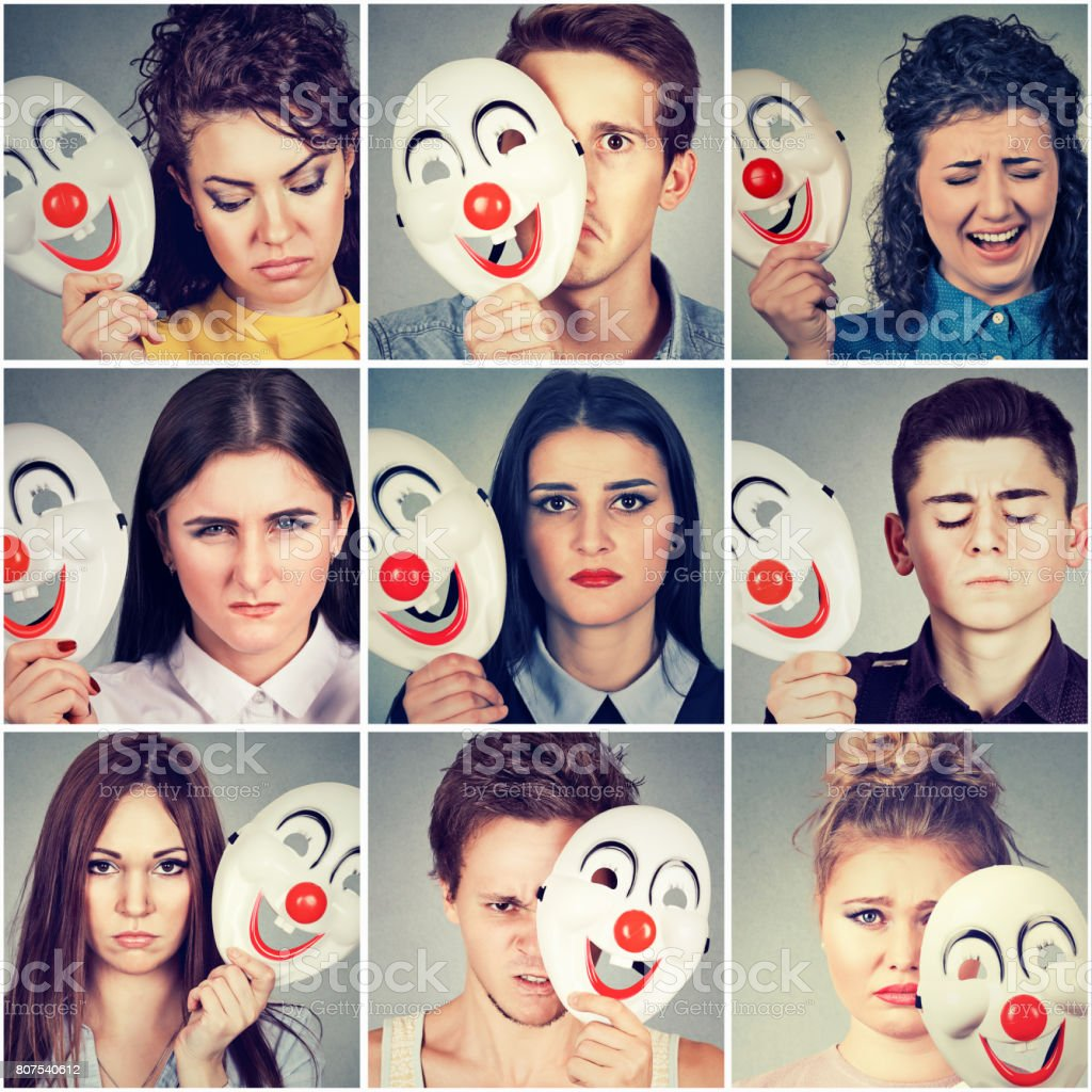 Group of sad angry people hiding real emotions behind clown mask stock photo
