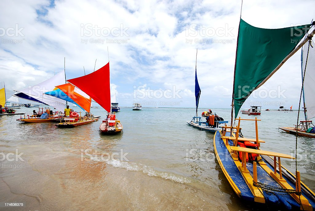 Group of sail boats on the coastline stock photo