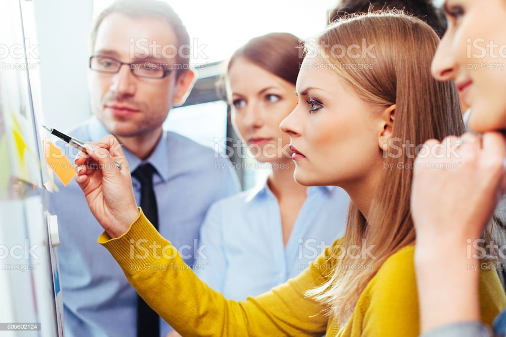 Group of salespeople looking at some data stock photo