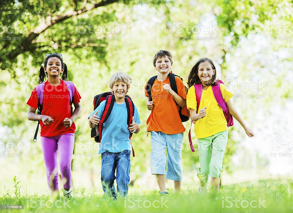 Group of school kids with backpacks. royalty-free stock photo