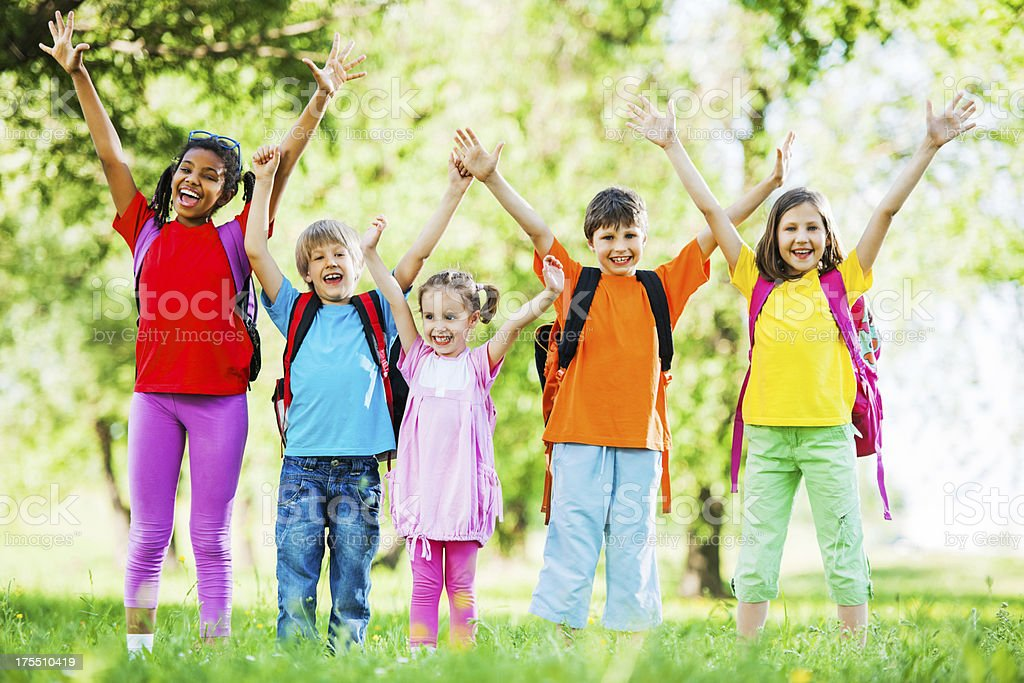 Group of school kids with raised arms. royalty-free stock photo