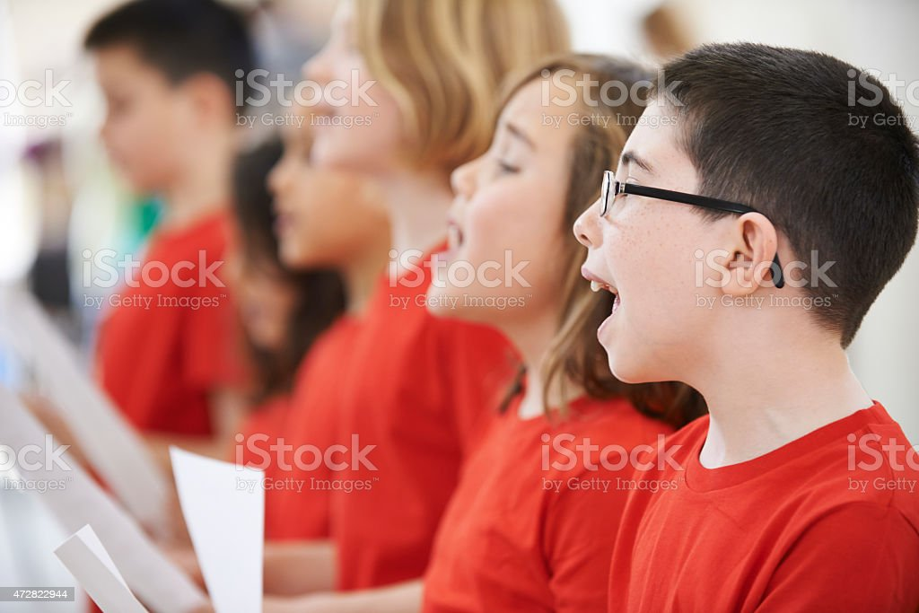 Group of school pupils in red clothes singing in choir stock photo
