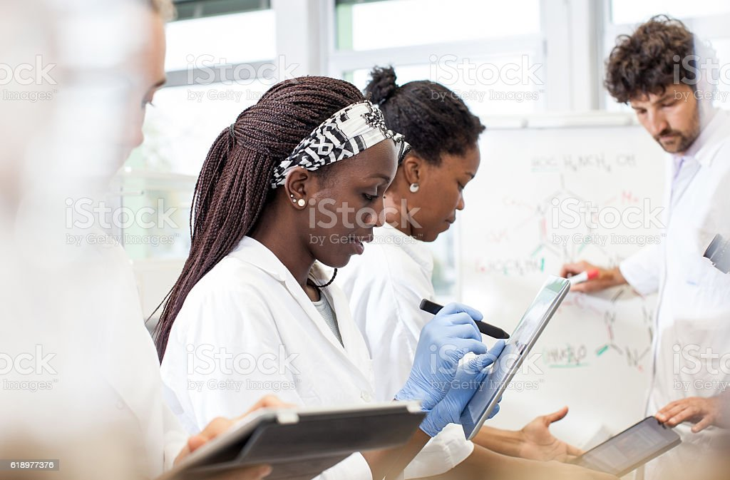 Group of Scientists Discussing New Findings on a Lab Meeting stock photo