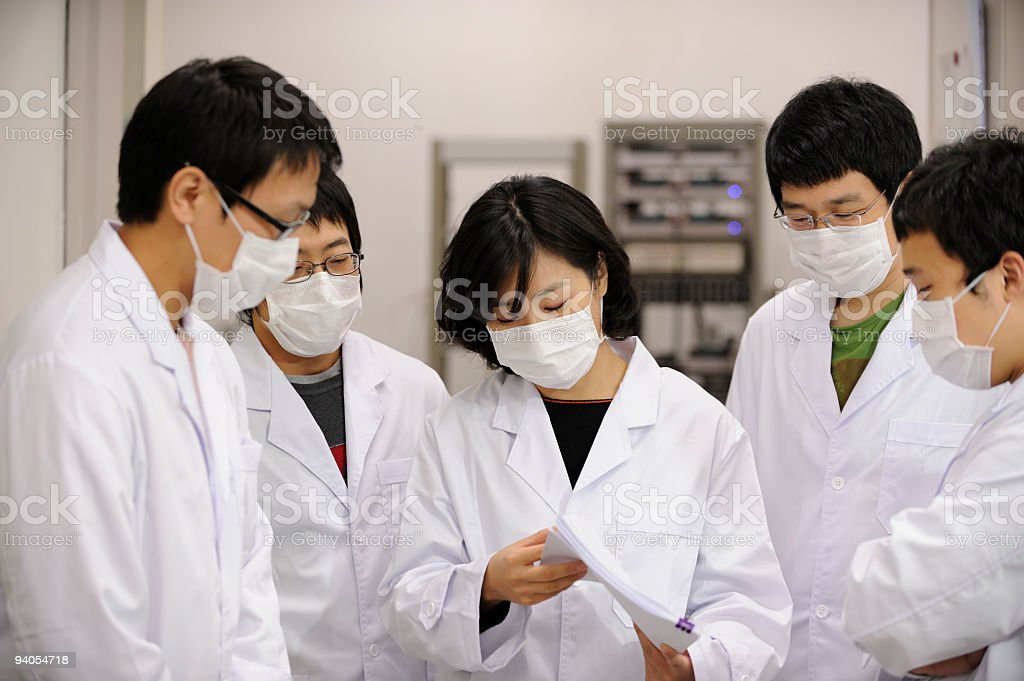 Group of scientists wearing surgical masks for H1N1 prevention royalty-free stock photo