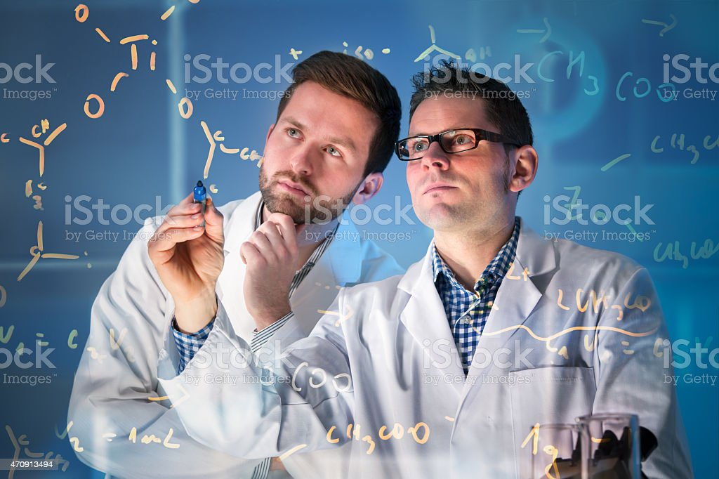 Group of scientists working at media screen stock photo