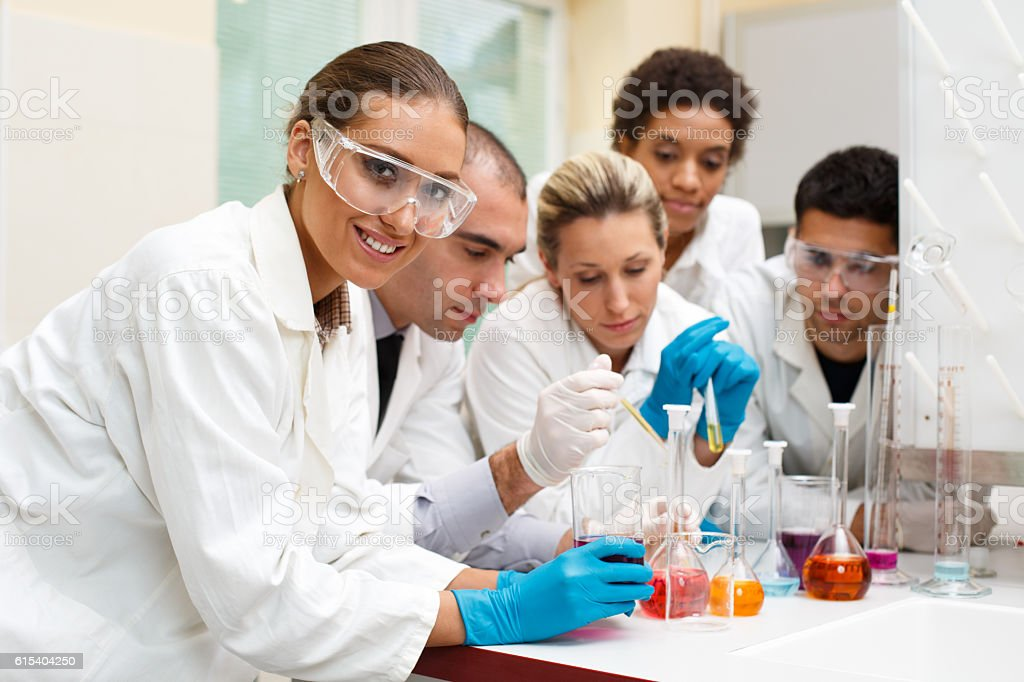 Group of scientists working in laboratory stock photo