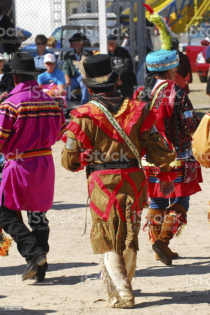 group of seminole men from behind stock photo