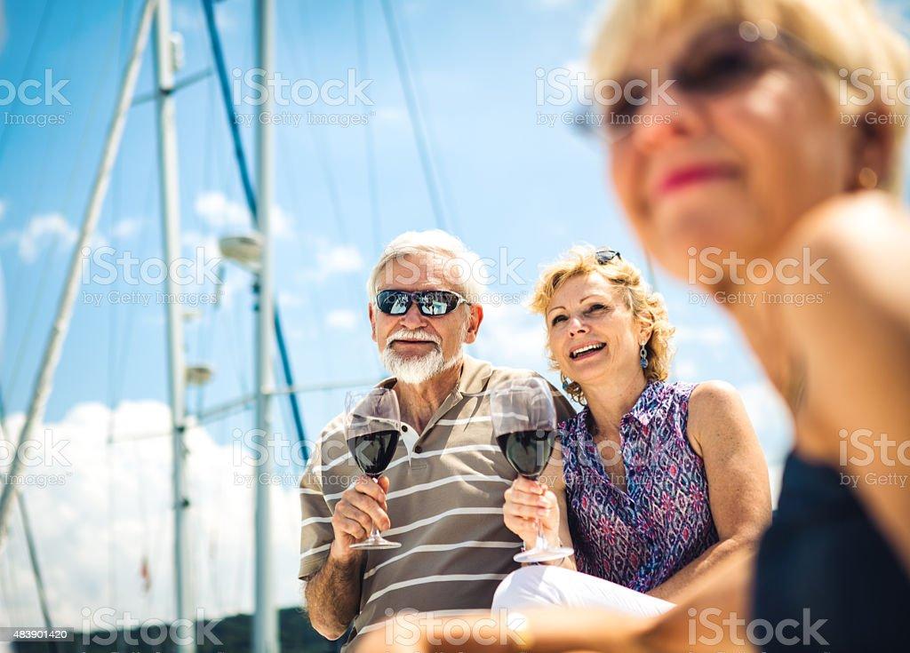 Group Of Senior Friends Enjoying On The Yacht stock photo