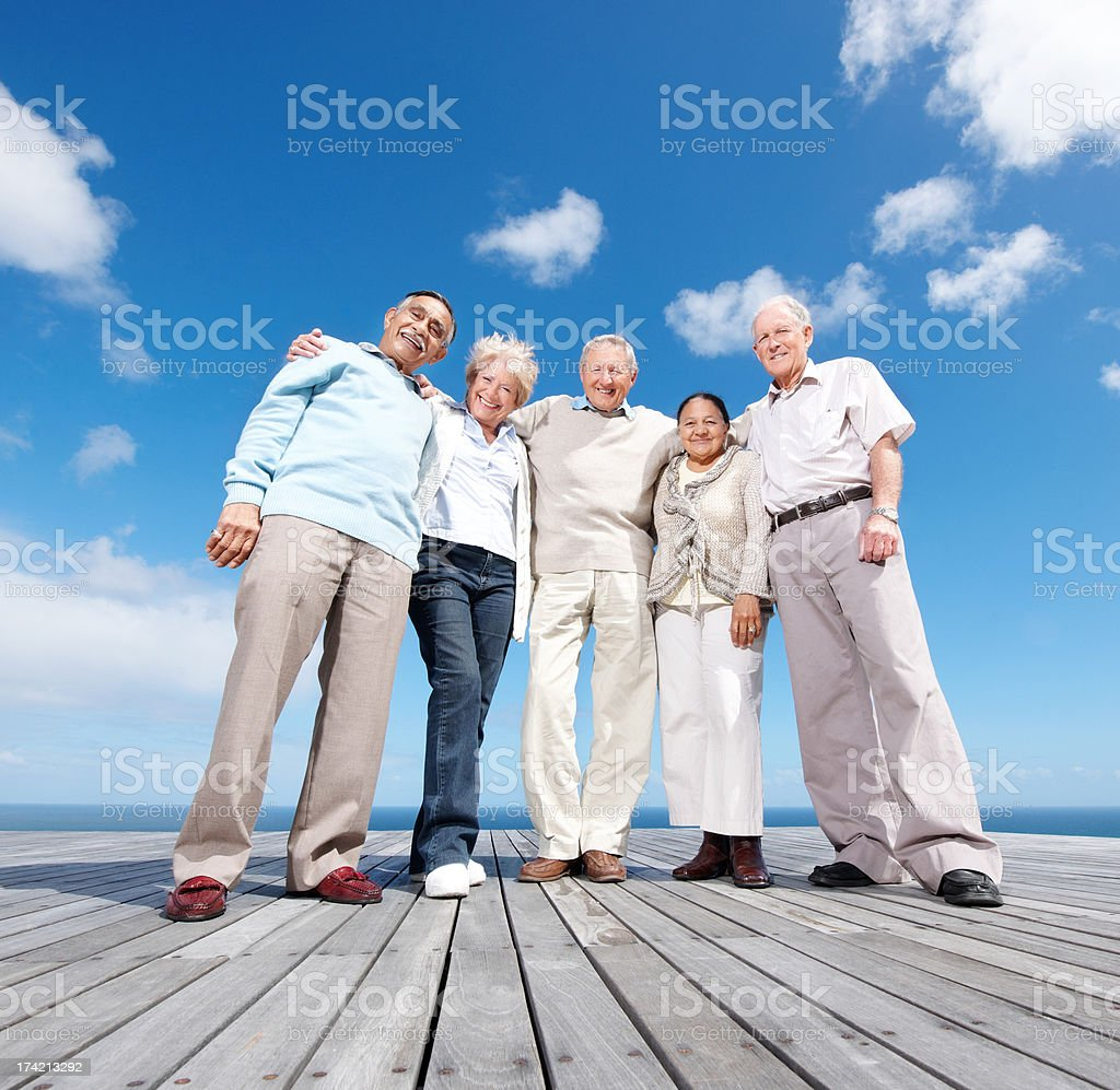 Group of senior friends enjoying their vacations stock photo