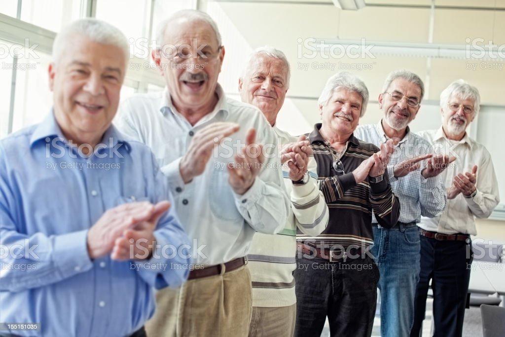 Group of senior men applauding stock photo