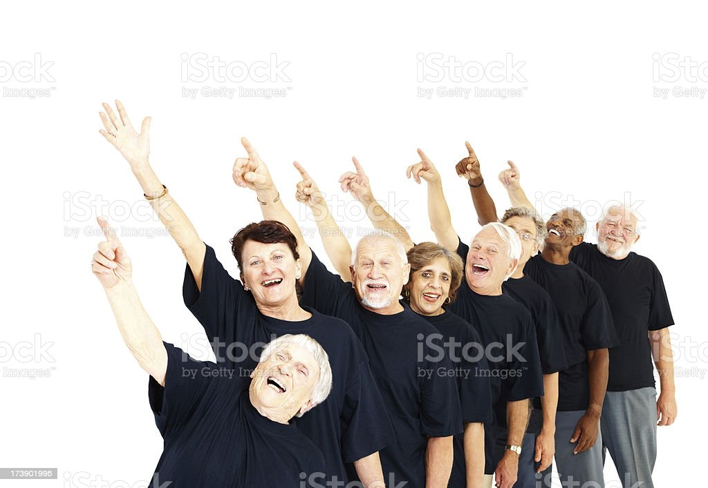 Group of senior people in line pointing away royalty-free stock photo