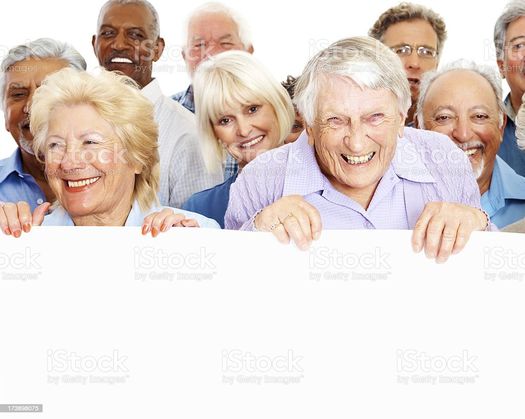 Group of senior people with an empty billboard royalty-free stock photo