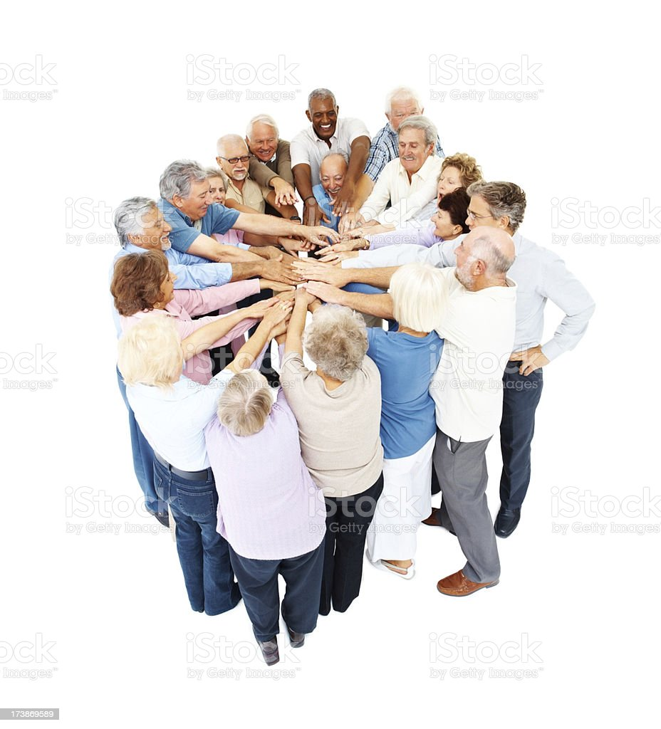 Group of senior people with their hands together royalty-free stock photo