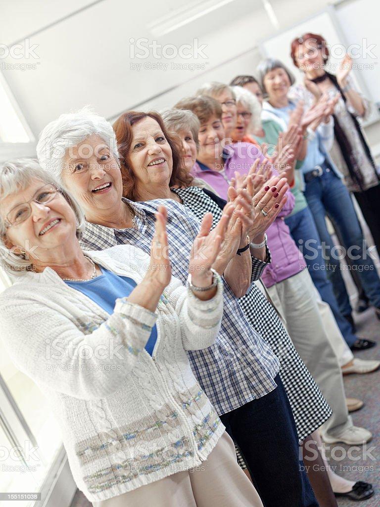 Group of senior women applauding royalty-free stock photo