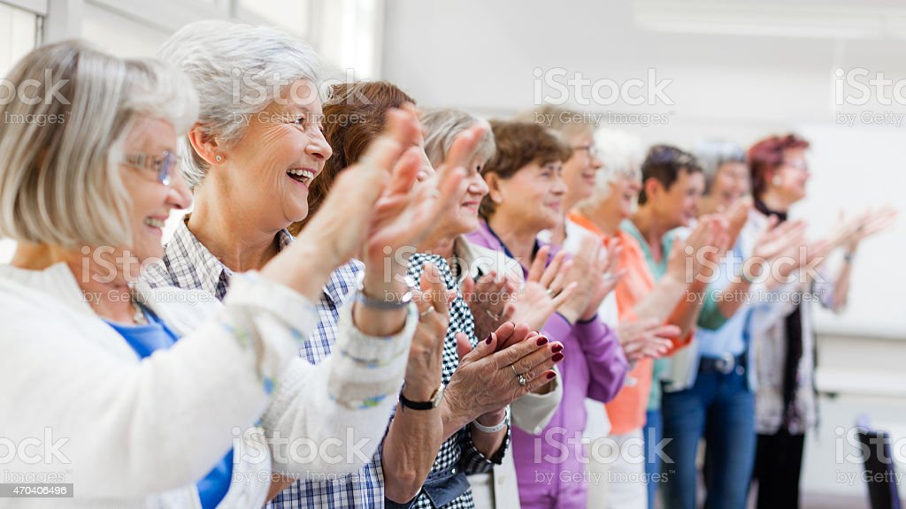 Group of senior women applauding stock photo