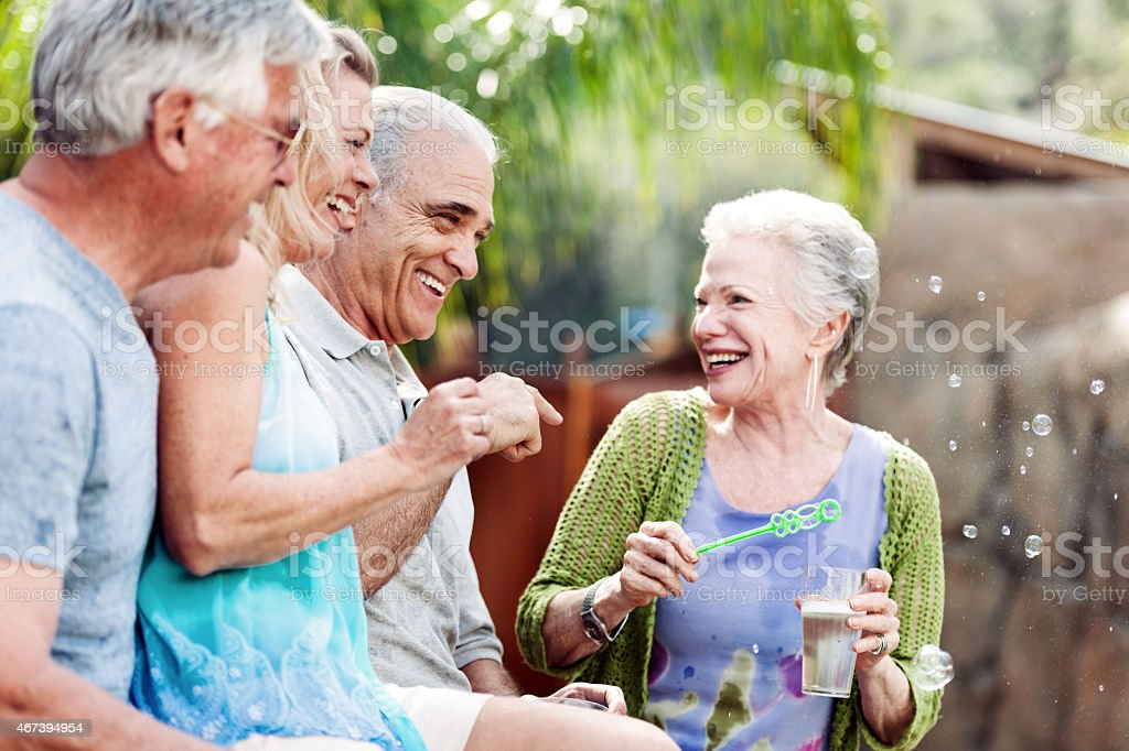 Group of seniors doing bublbles in the jacuzzi stock photo