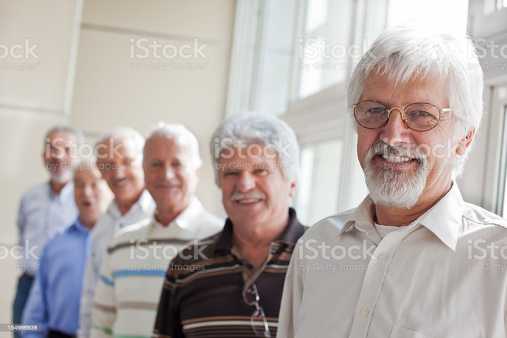 Group of seniors in a row stock photo