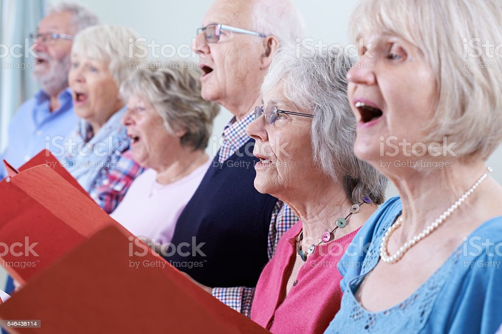 Group Of Seniors Singing In Choir Together stock photo