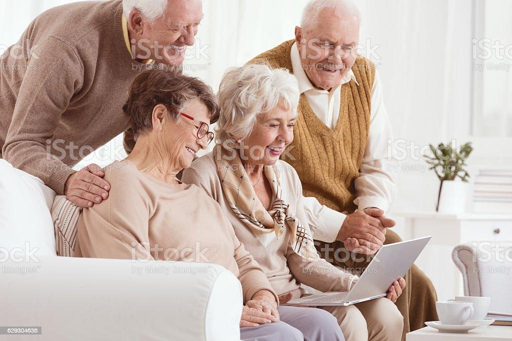 Group of seniors using laptop stock photo