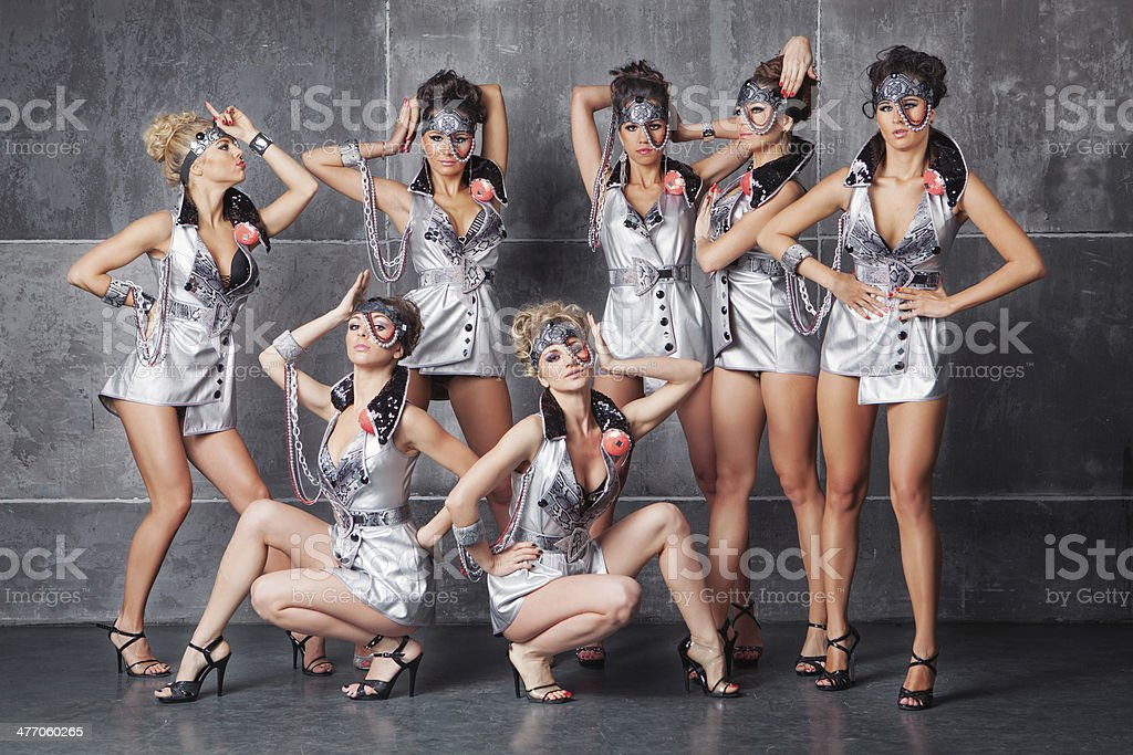 Group of seven happy cute girls in silver go-go costume stock photo