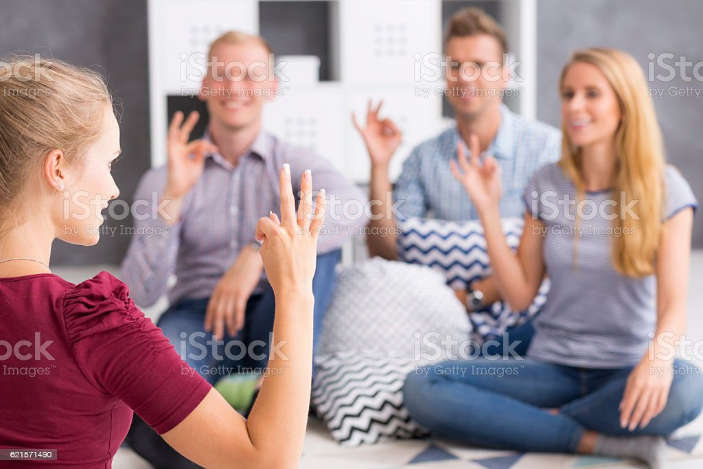 Group of sign language learners stock photo