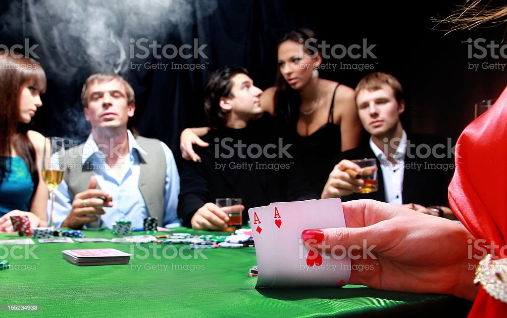 group of sinister poker players royalty-free stock photo