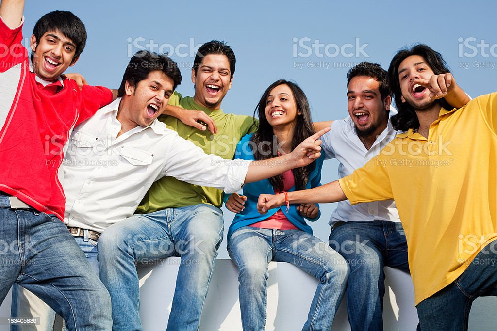 Group of Six Cheerful Excited Indian Friends Male Female Pointing royalty-free stock photo