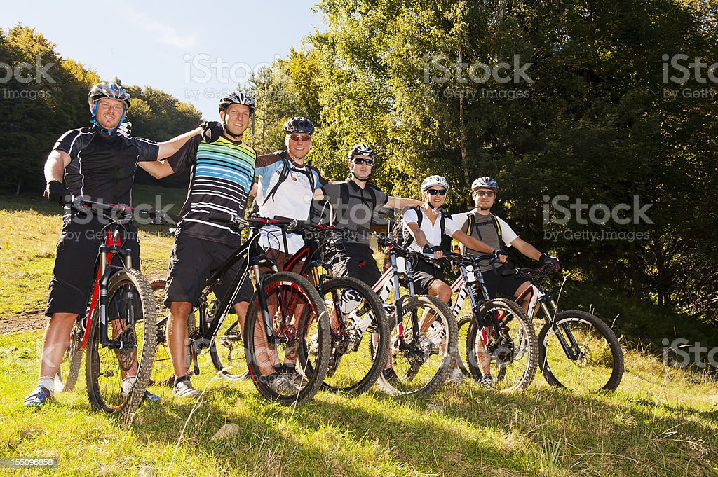 Group of six mountain bikers ready for downhill royalty-free stock photo