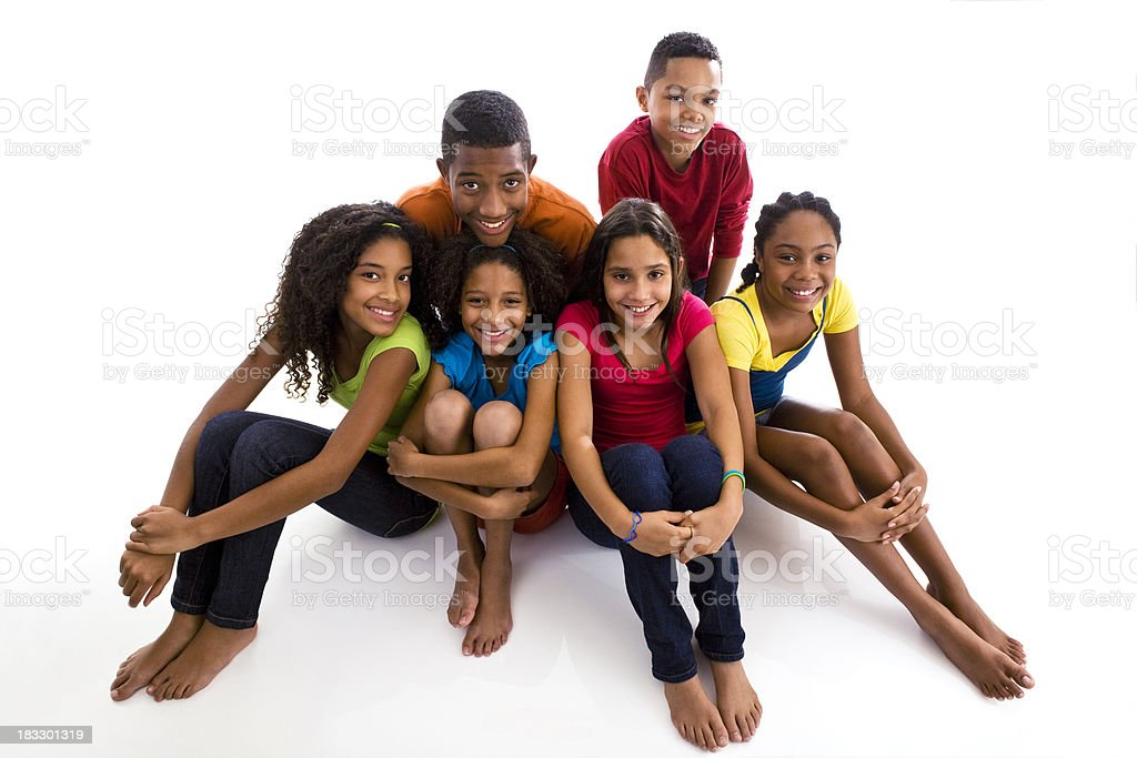 Group of six teenagers sitting on floor looking up royalty-free stock photo