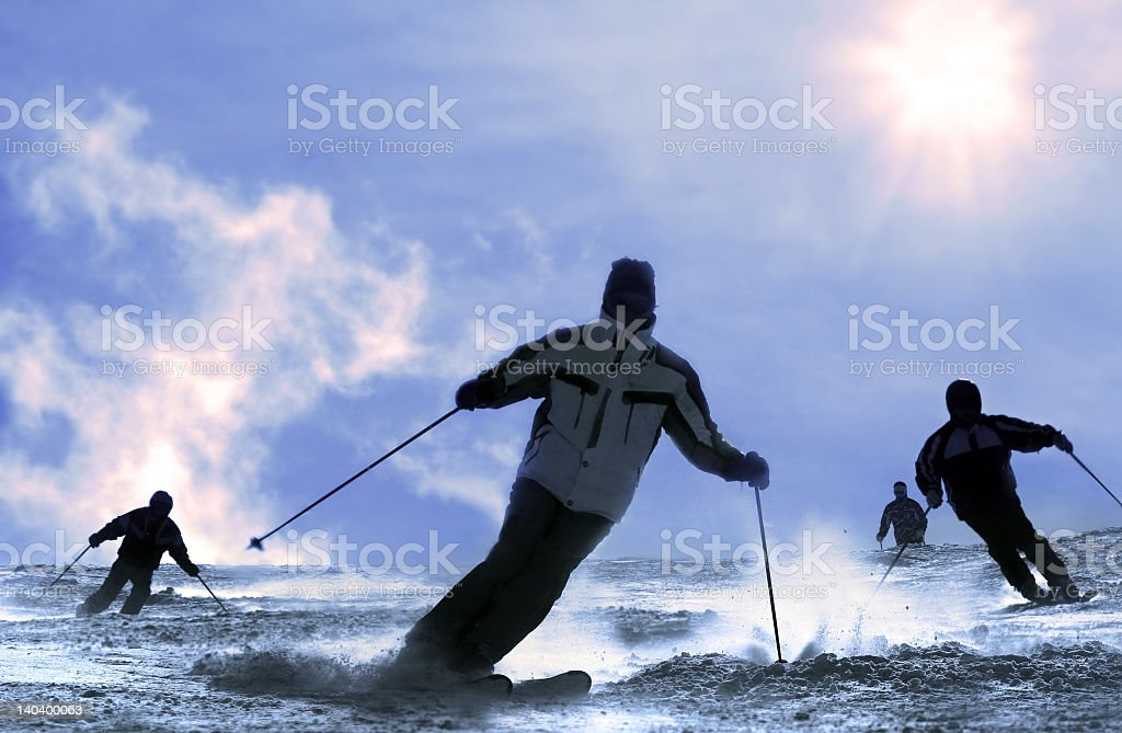 Group of skiers coming down the slope royalty-free stock photo