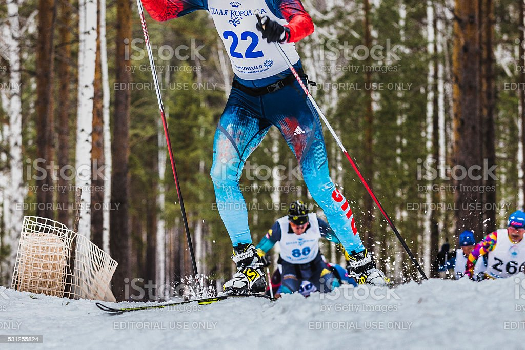 group of skiers male athletes up mountain stock photo
