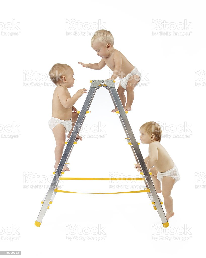 group of small babies climbing on stepladder royalty-free stock photo