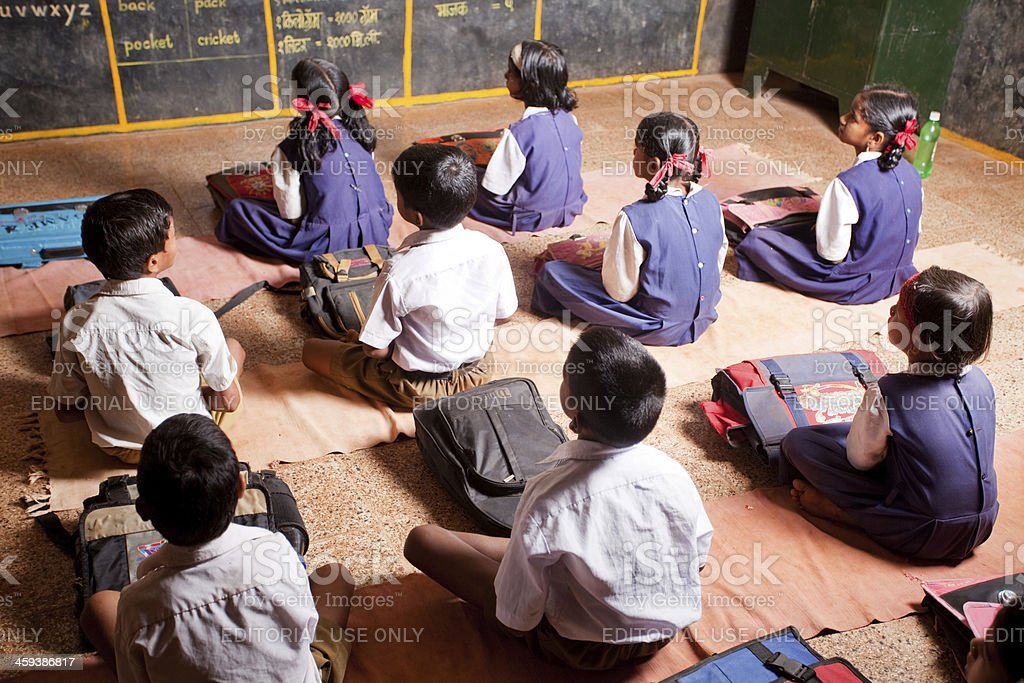 Group of small Indian children in a Rural School Classroom stock photo