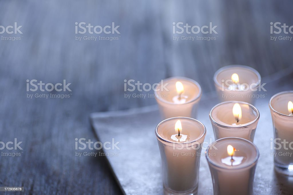 Group of small lit votive candles royalty-free stock photo